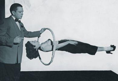 Magician performing gravity-defying trick