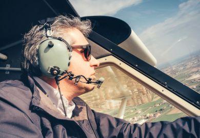 Male amateur pilot flying light aircraft