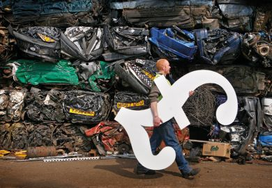 Male scrapyard worker carrying GBP pound sterling symbol