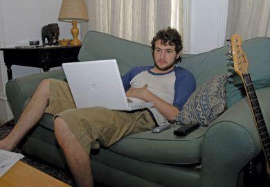 Male student using Apple laptop