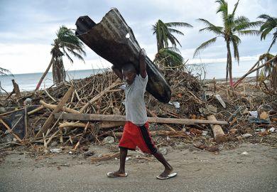 Man carrying corrugated tin