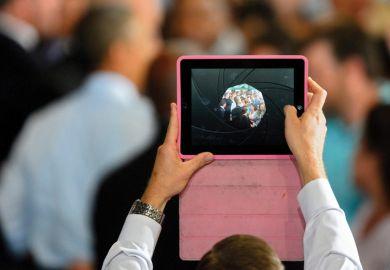 Man filming video using Apple iPad