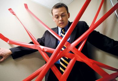 Man held back by red tape