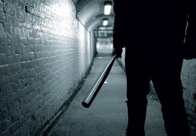 Man holding baseball bat in tunnel