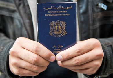 Man holds Syrian passport, Luebeck, Germany, 2015