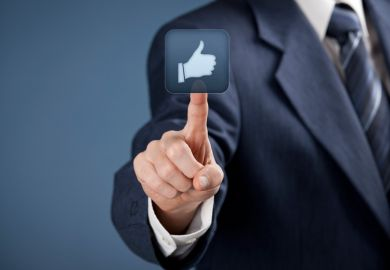 Man in suit pressing 'Like' button on touchscreen