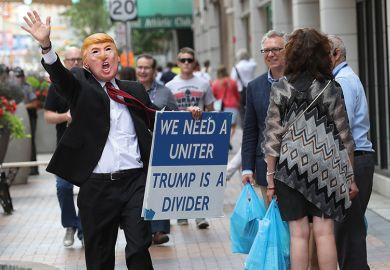 Man in Trump mask
