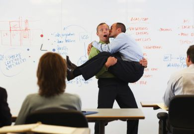 Man kissing man in front of classroom