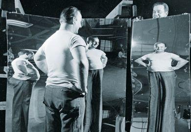 Man looking in funhouse mirror