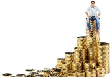 Man sitting on pile of money