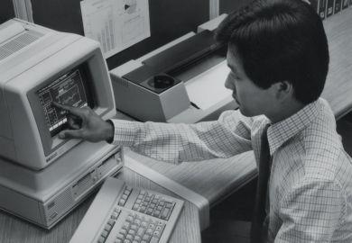 Man using Hewlett Packard HP-150 touchscreen computer