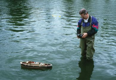 Man using remote-controlled boat