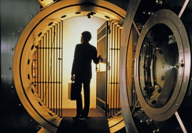 Man walking into bank vault