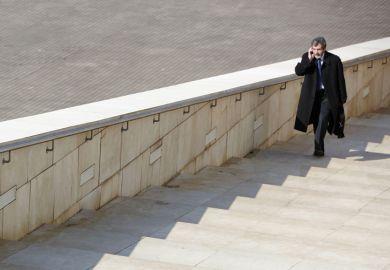 Man walking up steps Guggenheim Museum, Bilbao, Spain