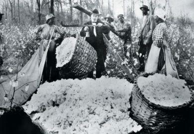 Man weighing basket of cotton balls, 1890s