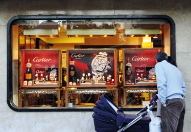 Man window shopping for Cartier watches, Córdoba, Spain