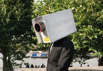 A man with a CCTV camera on his head