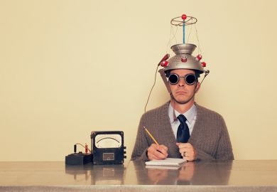 Man with colander on his head connected to electrodes