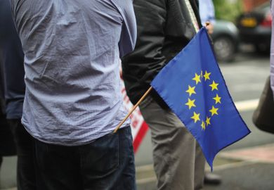 Man with European Union (EU) flag in back pocket