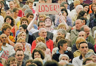 Man with loser sign in crowd
