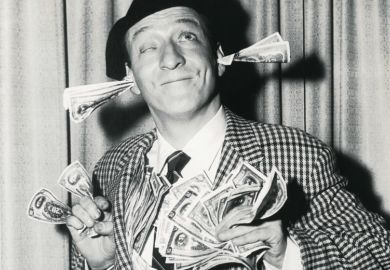 Smiling man with banknotes stuffed in ears and hands