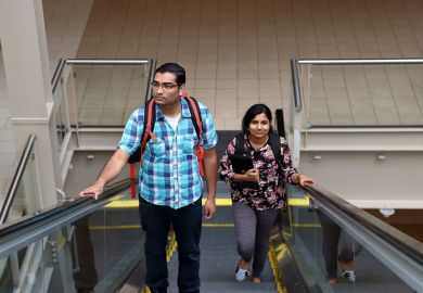 Man and woman going up escalator