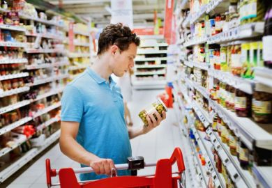 Man choosing in supermarket