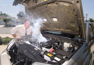 Man with overheating car