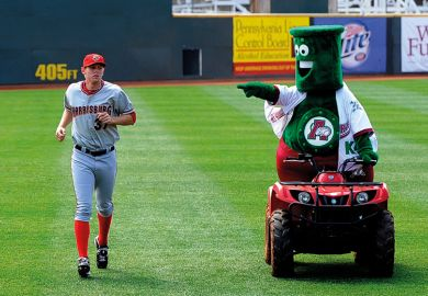 Mascot mocking baseball player