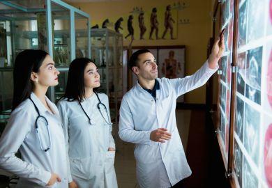 Medical students look at a chart
