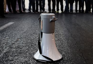 Megaphone on road in front of crowd of people