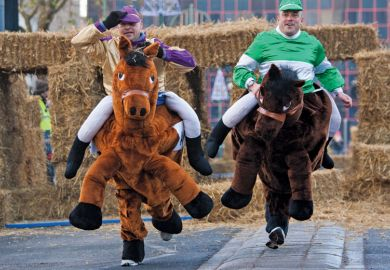 Men competing in pantomime horse race, Birmingham