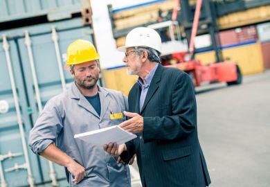 Men discussing paperwork on ship dock