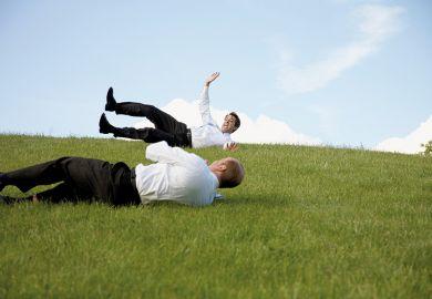 Men rolling down a hill