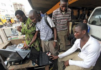 Men working on laptops, Obalende District, Lagos, 2010