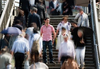 Man standing out from crowd.