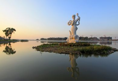 a mermaid statue in China