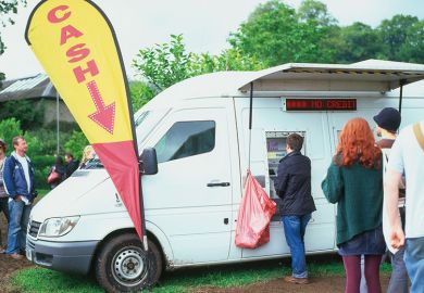 Mobile cash machine white van at the Green Man Festival Wales UK