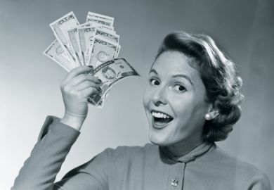 Woman holds up money