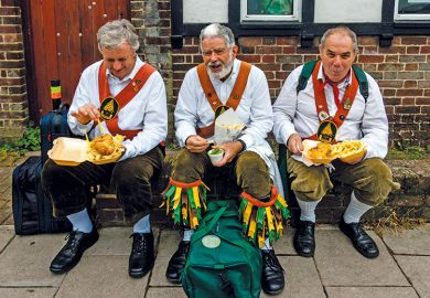Morris dancers eat fish and chips