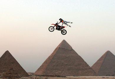 Motorbike jumping the pyramids