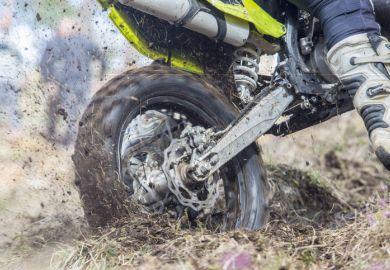 A motorbike stuck in the mud