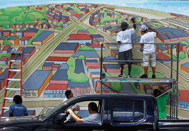 'Bird's Eye View of Allston Village' is on the side of a building in Cambridge, Mass