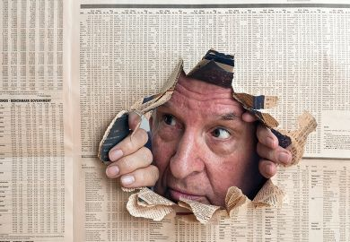 Man peeks through hole in newspaper