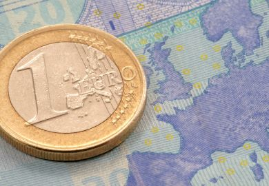 One Euro coin placed on map of Europe