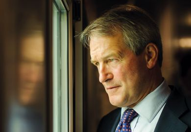 Owen Paterson looking out of window