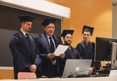 Professors attend an online Engineering bachelor of arts graduation exam at Politecnico di Milano, on March 05, 2020 in Milan, Italy