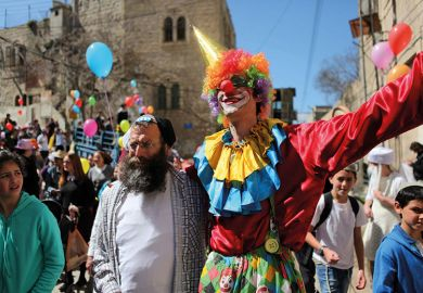 Jewish people celebrate festival of Purim in Hebron, West Bank