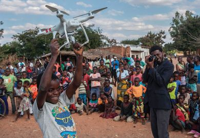 Boy holding drone