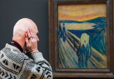 A visitor looks at 'The Scream' by Edvard Munch at the Tretyakov Gallery, illustrating a review of 'Why We Are Restless: On the Modern Quest for Contentment' by Benjamin Storey andJenna Silber Storey